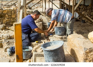 4 May 2018 Tradesmen doing restoration work on a recently discovered site at the ancient village of Magdala in Galilee Israel.