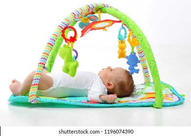 4 month old Baby is lying on the playing Mat. The concept of development of the newborn.