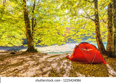 4 November 2018, Bolu-Turkey: Beautiful autumn views of Nazli Lake with red camping tent in (seven lakes) Yedigoller National Park. Bolu is a province in northwestern Turkey.