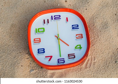 4 o'clock and 30 minutes over the sand background