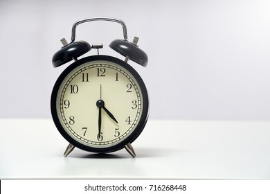 4 o'clock and 30 minutes over white background. Time management concept