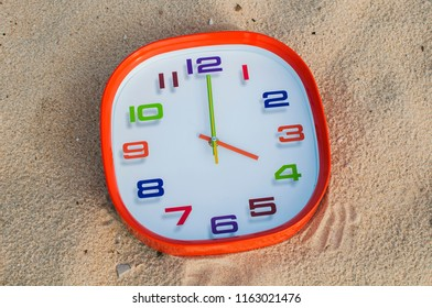 4 o'clock over the sand background