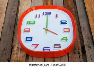 4 o'clock over wooden background