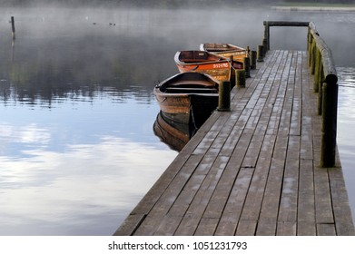 4 Oct, 2003. Jelling, Denmark. Early morning by the lake. Mist, boats, boardwalk. Fall, autoumn.