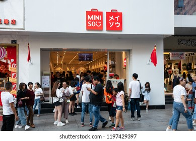 4 October 2018, Wuhan China : Exterior of Miniso flagship store with people in Wuhan China