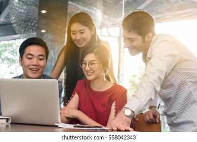 4 people meeting in coffee shop, business casual conceptual