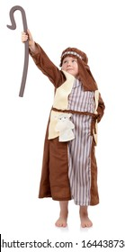 4 year old boy in nativity play dressed as Shepard holding up staff isolated on a white background.