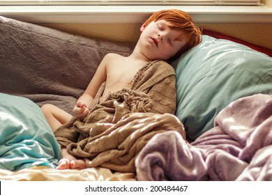 4 year old boy sleeping in his bed with a fever -- image taken in Reno, Nevada, USA