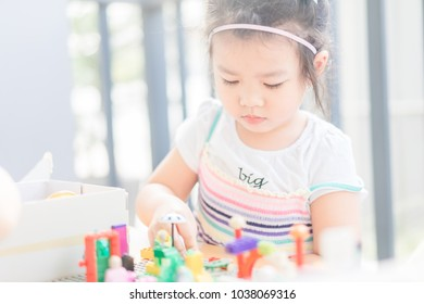 4 years girl.Little child girl playing with lots of colorful plastic toys outdoor with mother.Kids play with educational toys at home.Day care and Kindergaten school.child development concept.
