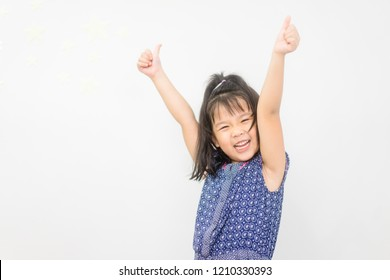4 years Happy little asian girl with hands up and thumbs up mean excited and like.Successful concept.