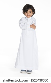 4 years old Arab Saudi boy with different poses expressions and props on a white isolated background, ready for cutout and design purposes.