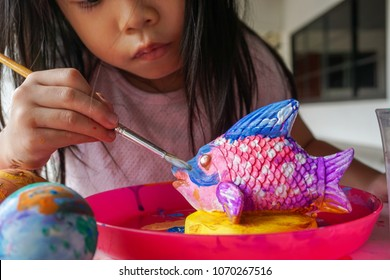 4 Years old Asian little cute girl  painting. Painting is play therapy for ADHD kids (Attention deficit hyperactivity disorder),can be used to address emotional problems.