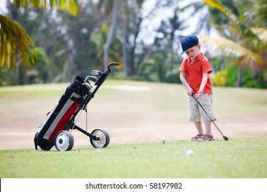 4 years old boy playing golf