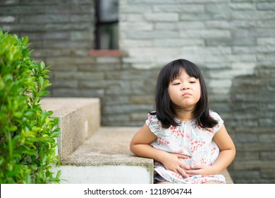 4 years old Little asian girl need a poo and hungry in the park playground.