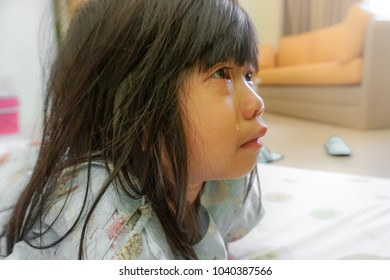 4 Years old little cute girl with Influenza hospital admission, crying with tearful on her face. Homesick child, Kid with attention deficit hyperactivity disorder (ADHD) can't handle her emotion.