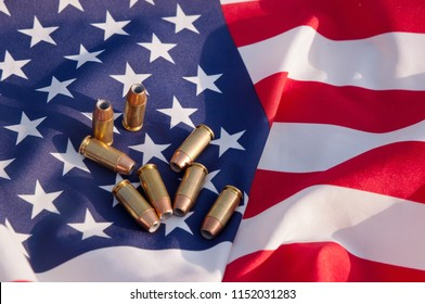 40 caliber hollow point bullets shown with an American flag background