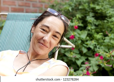 40 year old woman resting in the garden