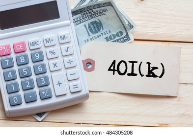 401(K) budget Words on tag with dollar note and calculator on wood backgroud,Finance Concept