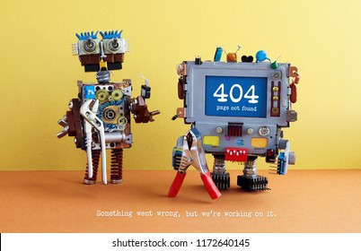 404 error page not found. Serviceman robots with pliers on yellow brown orange background. Text message Something went wrong but we are working on it.