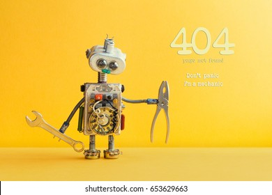404 error page not found concept. Don't panic I'm a mechanic. Hand wrench pliers robot handyman on yellow background. Cyborg toy lamp bulb eyes head, electric wires, capacitors vintage resistors.