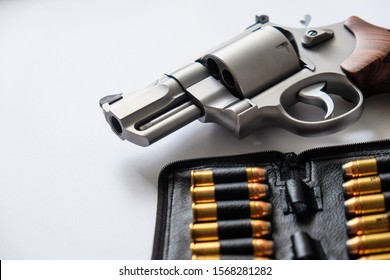 .44 magnum revolver gun with jacket soft point bulet on white background