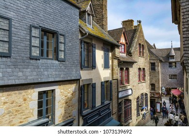 4/4/207 - Mont Saint Michel, France: Shoppers and tourists walk along the narrow Grand Rue in this medieval town, a UNESCO world heritage site.