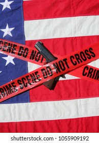 .45 pistol with an American Flag, and Sheriff's Line Do Not Cross and Crime Scene Tape. Represents the Second Amendment, the right to own guns, and the current anti gun politics. march for life