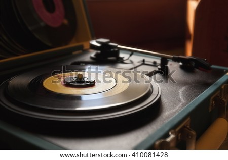 45 record vinyl disc on a vintage portable turntable.
