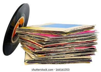 45 rpm vinyl discs stack on white background