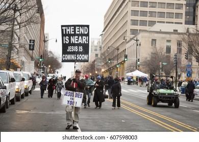 45th Presidential Inauguration, Donald Trump: The End Is Near Jesus Is Coming on a sign held by a demonstrator outside the security checkpoint, WASHINGTON DC - JAN 20 2017