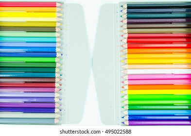 48 wooden color pencils in box isolated on white background