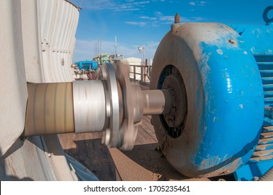 480 volts, 250 hp motor to move the blades of a giant cooling fan from a cooling tower in a geothermal power plant, motion blur from the spinning shaft from the motor and the axe of the fan