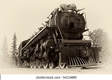 """Un moteur à vapeur de type """"4-8-4"""" ou """"Northern"""" construit par The Montreal Locomotive Works pour le Canadien National en 1942. Le style est dans une image vintage du début du XXe siècle / fin du XIXe siècle."""