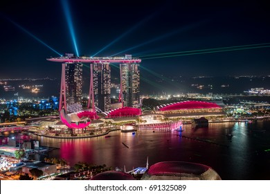 4/8/7 height view looking at Marina Bay Sand at night while having fountain and lighting show, Singapore