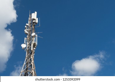 4G and 5G cell site. Base Station or Base Transceiver Station. Wireless Communication Antenna Transmitter. Telecommunication tower with antennas against blue sky.