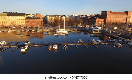 4K aerial view drone photo of Helsinki bay area near sea terminal Katajanokka and harbour with city skyline, moored boats and vessels and Baltic Sea view in the capital of Finland, northern Europe
