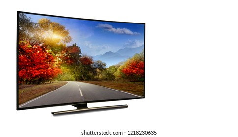 4k monitor isolated on white.  The road is rural, unpaved in the steppes at sunset. Modern, elegant TV 4 K, with incredibly beautiful colors of the image.