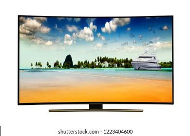 4k monitor isolated on white.  Andaman Sea, Phuket Island. Thailand.. Modern, elegant TV 4 K, with incredibly beautiful colors of the image ..