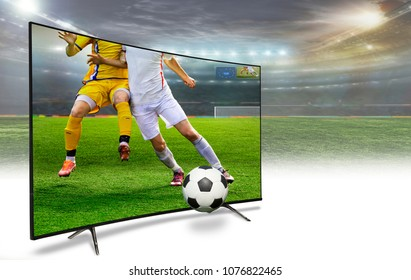 4k monitor watching smart tv translation of football game.liquid crystal monitor on the background of the stadium broadcasts the match in the evening time of the World Cup 2018.  Concept