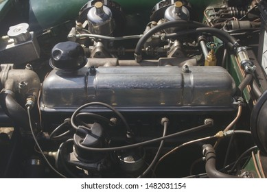 4th August 2019- The 1275cc engine in in a classic MG Midget sports car being displayed at a vintage vehicle show in Burry Port, Carmarthenshire, Wales, UK.