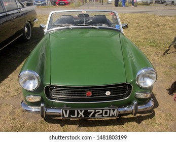 4th August 2019- A 1974 green MG Midget sports car being displayed at a vintage vehicle show in Burry Port, Carmarthenshire, Wales, UK.
