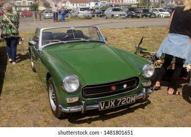 4th August 2019- A classic MG Midget sports car being displayed at a vintage vehicle show in Burry Port, Carmarthenshire, Wales, UK.