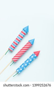 4th of july firework. USA flag style rockets on blue background top view. Independence day celebration firecrackers.