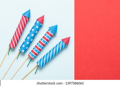 4th of July fireworks USA flag style rockets. Firecracker rockets United States Independence Day banner with copy-space.
