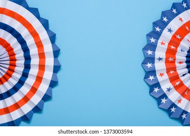 4th of July holiday banner design. USA theme paper fans on blue background flat lay. Independence Day lanterns template with copy space.