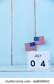 4th of july Wooden calendar and  american flags for memorial day or veteran's day background