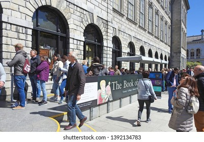 4th May 2019, Dublin,Ireland. Large queue of people in Trinity College campus waiting to see the 9th century manuscript Book of Kells.