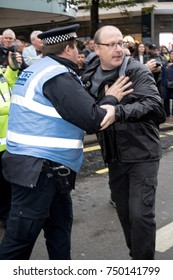 4th November 2017, London, United Kingdom:-Unidentified protester scuffles with a police officer at a pro Palestine rally