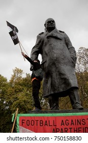 4th November 2017, London, United Kingdom:-Pro palestine protester standing on the statue of Winston Churchil in parliment square