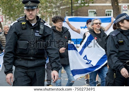 4th November 2017, London, United Kingdom:-Police officers march infron of Pro Israeli protestors to keep pro Palestine protesters away